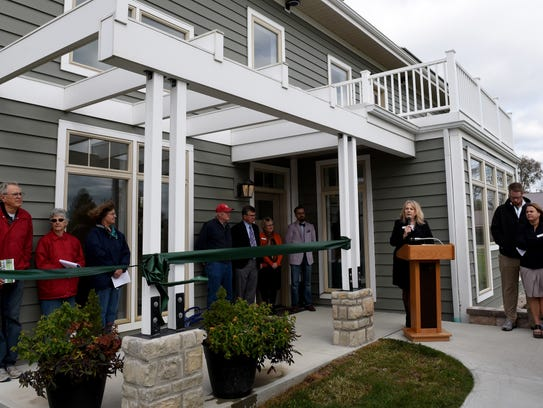 Buy Photo C-TEC Superintendent Joyce Malainy welcomes guests to the ribbon-cutting of the school's net-zero energy model home.(Photo: Sara C. Tobias/The Advocate)