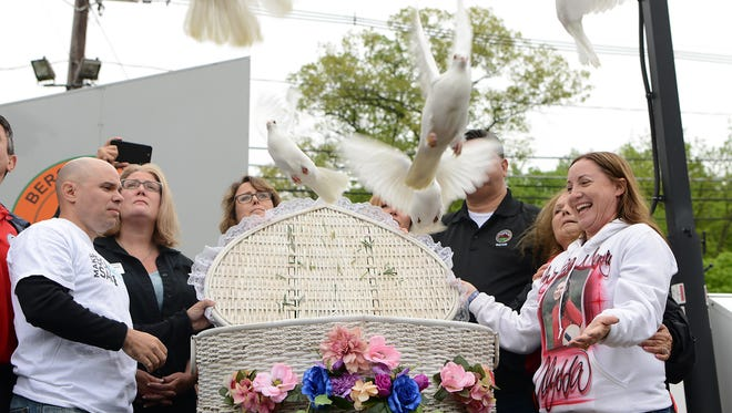 Woodcliff Lake Pear Blossom festival on Saturday May 12, 2018. (Right) Lori Alhadeff and her husband (left) Ilan Alhadeff, release 17 doves at the festival in remembrance of the 17 lives lost during as a result of the Parkland shooting. Their daughter, Alyssa Alhadeff, was a victim  of the shooting and used to live in the borough.