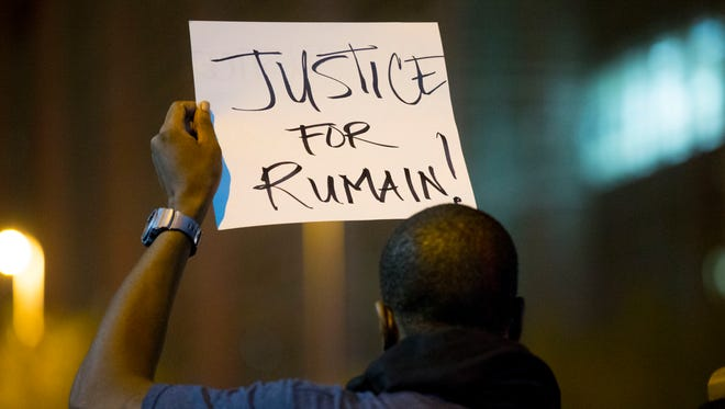 People pour into the streets during a Dec. 4 rally near Phoenix Police headquarters to protest the death of Rumain Brisbon, an unarmed Black man who was shot by a Phoenix police officer.