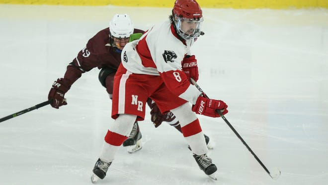 North Rockland's Luke Mac Millian (8) controls the puck during their 5-1 win over Orchard Park in the Fabulous 15 Hockey Tournament at The Ice Hutch in Mount Vernon on Saturday, December 2, 2017.