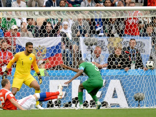 Artem Dzyuba of Russia scores the third goal in a 5-0