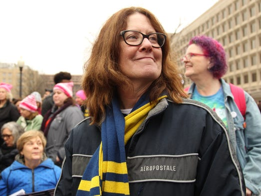 Adrienne Bliss, of Muncie, listens as speakers fire