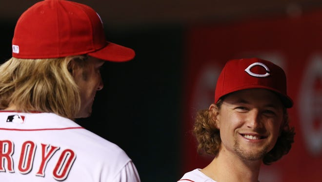 Former Red Bronson Arroyo, left, admitted he might let out a giggle on the mound considering he'll be facing his friend Mike Leake, right.