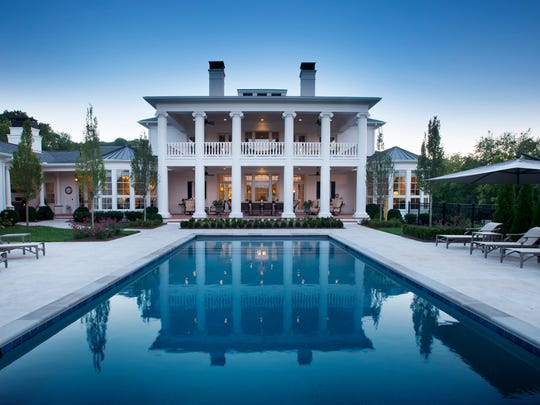 At this Greek Revival home in Leiper's Fork, the saltwater pool features an 8-foot sun shelf at the shallow end. The pool terrace is constructed of tumbled travertine.
