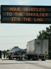 A sign on Interstate 85 reminds drivers involved in a fender-bender to move to the shoulder of the road.