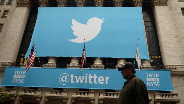 A banner with the Twitter logo on the front of the New York Stock Exchange on Nov. 7.