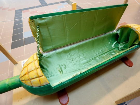 Iowa State Engineers Without Borders members are auctioning off a Ghanaian fantasy coffin shaped like an ear of corn to help fund an earthen dam project in a village in Ghana.