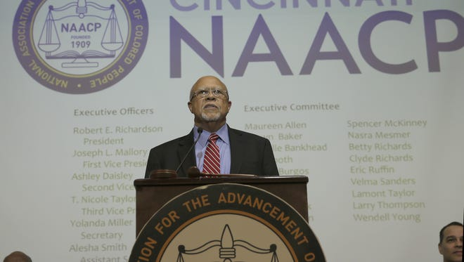 Robert Richardson Sr., new president of the Cincinnati chapter of the NAACP, speaks during Thursday's ceremony.
