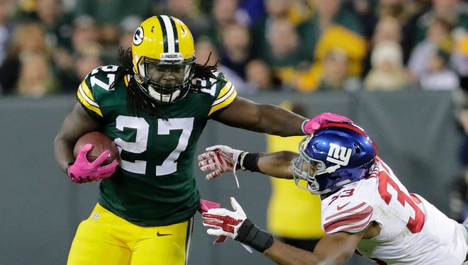 Green Bay Packers running back Eddie Lacy runs for a first down against New York Giants defender Andrew Adams in the second quarter at Lambeau Field.