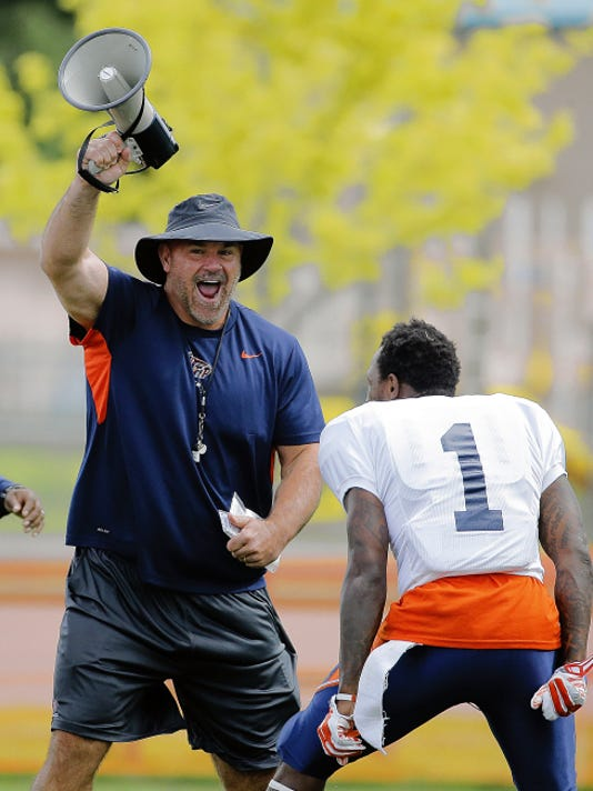 MARK LAMBIE-EL PASO TIMES UTEP head coach Sean Kugler celebrates after a tough hit which caused a fumble by his defense Monday at Camp Ruidoso.