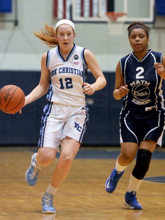 Christian School of York's Mekenzie Smith, left, drives alongside Math, Civics and Sciences' Camille Kerrin during Saturday's PIAA Class AA tournament first-round game at Dallastown. CSY won, 44-41.