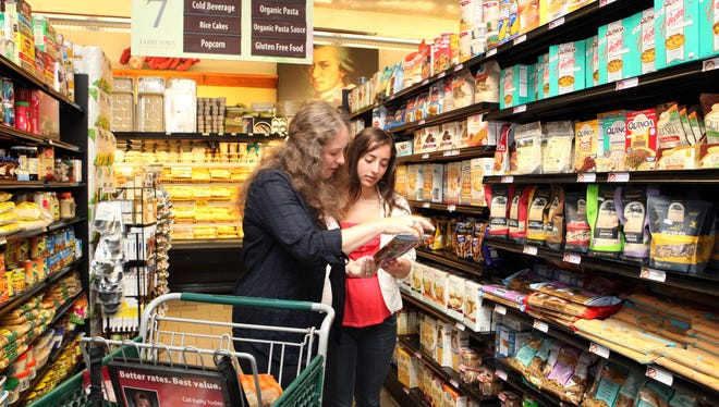 Celiac sufferers Maria Roglieri of Sleepy Hollow, N.Y.,  and her daughter, Sara Friedman, 16, shop in the gluten-free section at C-Town supermarket Wednesday, Aug. 13, 2013, in Tarrytown, N.Y.
