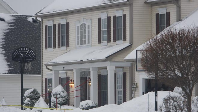 The scene outside 37 Coach Side Lane in Pittsford after a police discovered a homicide inside the home the night before.