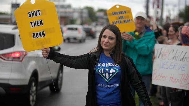 Crystal Bradley of Boys and Girls Haven, protested in front of the Economy Inn on Bardstown Rd.  The hotel has becomen known as a hot spot for drugs and protistution and was expecting a new health department rating today.  April 20, 2015.
