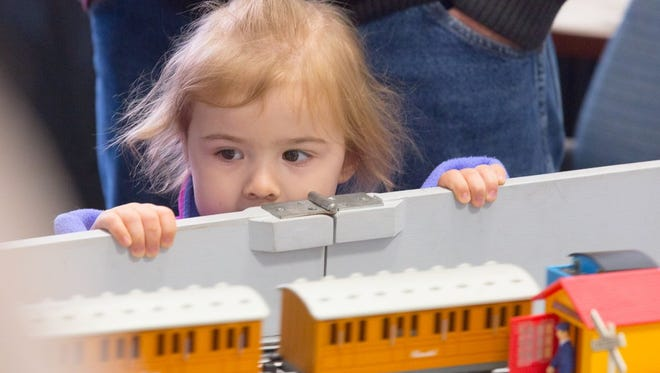 Harper Miller, 3, looks at trains on display at The Evening Sun open house.