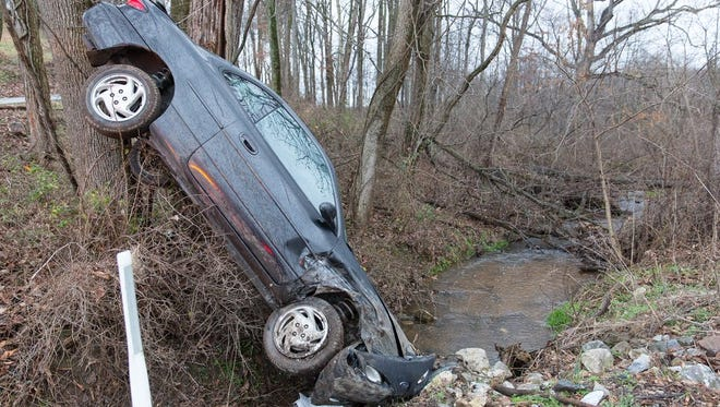 A vehicle crashed Thursday morning along Moulstown Road in Heidelberg Township. The two occupants in the vehicle - a father and son - were not injured, police said.