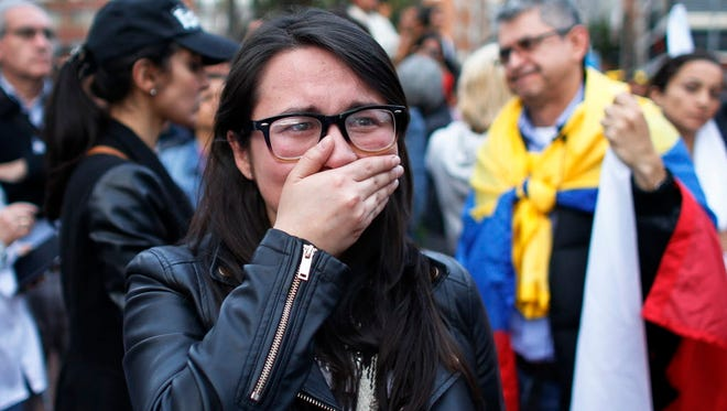 A supporters of the peace accord between the Colombian government and FARC follows the results of the referendum.
