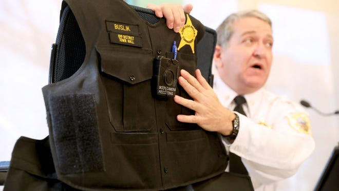 Chicago Police Department 19th District Commander Marc Buslik discusses the department's body camera policies and demonstrates its use on Wednesday, Dec. 28, 2016 at the district headquarters in Chicago.