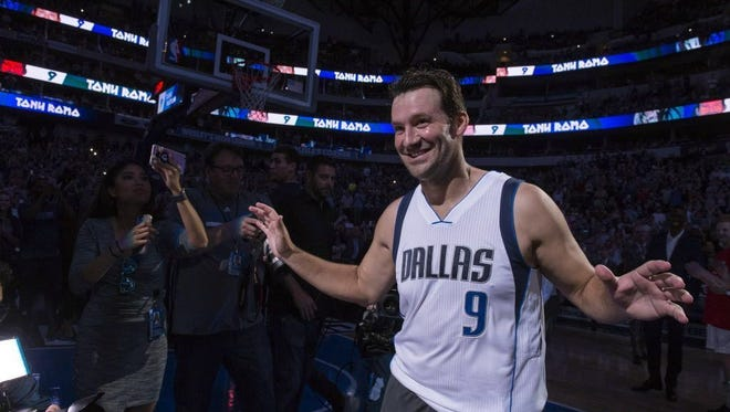 Former Dallas Cowboys quarterback Tony Romo (9) is introduced before the Dallas Mavericks' game against the Denver Nuggets.