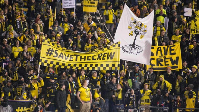 """Fans hold up  """"Save the Crew"""" signs during the Columbus Crew's playoff game against NYCFC at MAPFRE Stadium."""