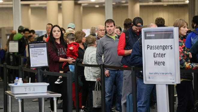 Passengers make their way through a security checkpoint at Mitchell International Airport in March. The airport has seen an increase in passenger traffic in the first six months of this year compared to the same time a year ago.