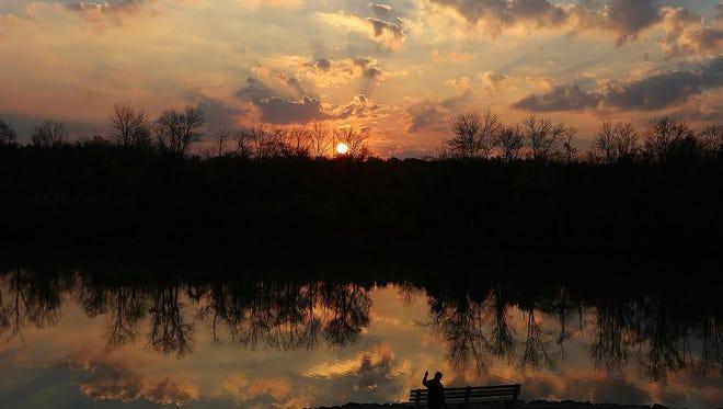 Sun rise at Winton Woods on Monday.
