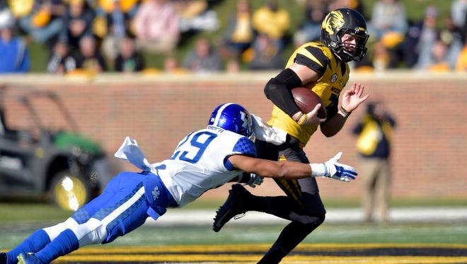 Nov 1, 2014; Columbia, MO, USA; Missouri Tigers quarterback Maty Mauk (7) runs the ball as Kentucky Wildcats cornerback Kendall Randolph (29) makes the tackle during the first half at Faurot Field. Mandatory Credit: Denny Medley-USA TODAY Sports