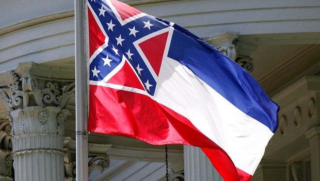 The state flag of Mississippi is unfurled against the front of the Governor's Mansion in Jackson/