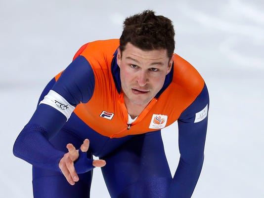 Sven Kramer of The Netherlands flashes three fingers for a triple of 5,000 meter Olympic gold medals after the men's 5,000 meters race at the Gangneung Oval at the 2018 Winter Olympics in Gangneung, South Korea, Sunday, Feb. 11, 2018. Kramer won with a devastating kick late in the race, coming back from behind to beat Ted-Jan Bloemen of Canada and setting a new Olympic record. (AP Photo/John Locher)