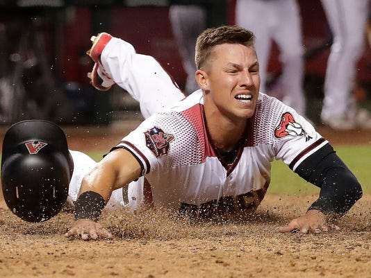 Arizona Diamondbacks' Jake Lamb scores the tying run against the Los Angeles Dodgers during the 15th inning of a baseball game off a base hit by teammate Nick Ahmed Tuesday, April 3, 2018, in Phoenix. The Diamondbacks won 8-7. (AP Photo/Matt York)