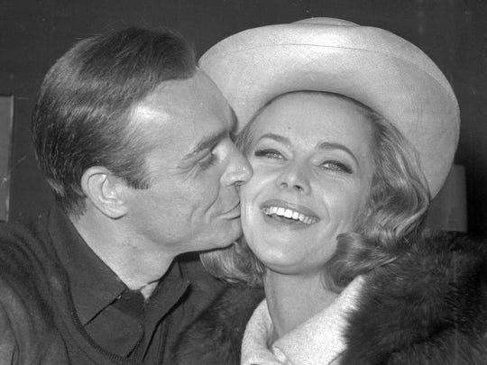British actor Sean Connery kisses actress Honor Blackman during a 1964 party at Pinewood Film Studios, in Iver Heath, England. Blackman, the actress best-known for playing Bond girl Pussy Galore, has died at age 94.