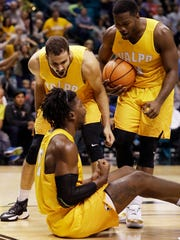 Valparaiso guard Shane Hammink, top left, guard Max Joseph, right, and forward Jubril Adekoya celebrate after a play against BYU during the second half of an NCAA college basketball game Wednesday, Nov. 23, 2016, in Las Vegas.