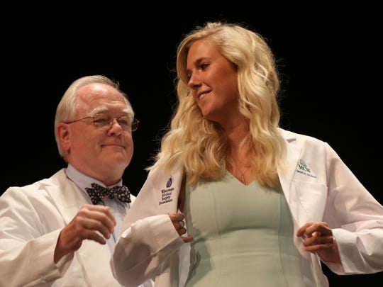 Camilla Dornfeld is coated during the Medical College of Wisconsin Central Wisconsin White Coat Ceremony at UW Marathon County, in Wausau, Wisconsin, July 7, 2016.