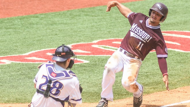 Missouri State infielder Jeremy Eierman (11) is tagged out by Tennessee Tech catcher Brennon Kaleiwahea (28) trying to score on a wild pitch in the NCAA Oxford Regional, at Oxford-University Stadium in Oxford, Miss. on Saturday, June 2, 2018. (Bruce Newman, Oxford Eagle via AP)