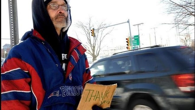 Norman Leduc stands off President Avenue and Davol Street in Fall River hoping for donations from passing motorists in this February 2018 file photo.