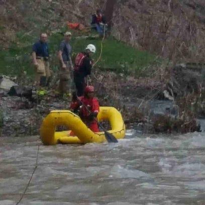 WATER RESCUE: Man, dog pulled from Lansing creek