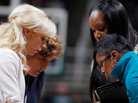 Michigan State head coach Suzy Merchant, left, and assistants Maria Fantanarosa, from left, Amaka Agugua-Hamilton, and Alysiah Bond discuss strategy during a timeout before passing on instructions to players against Indiana, Saturday, Jan. 20, 2018, in East Lansing, Mich. Michigan State fell 69-65.