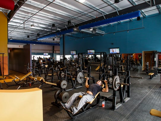 Carl Fatura of DeWitt works out at Conquest Fitness