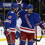 High-scoring Rangers stay hot with win over Oilers