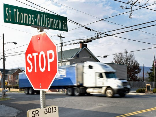 A big rig passes through a busy intersection at St. Thomas-Williamson Road and Lincoln Way West on Wednesday, November 16, 2016. Supervisors are studying the intersection for a possible traffic light.