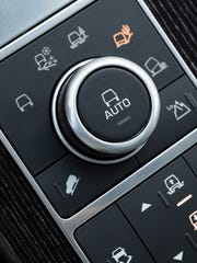 On the 2014 Land Rover Range Rover LWB terrain response console, drivers can indicate one of five surface types to optimize antilock brake, traction- and stability-control systems.