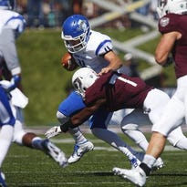 Indiana State quarterback Matt Adam is tackled by Missouri State's Tre Betts in the first half on Saturday.