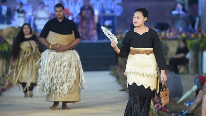 In Tongan funerals, family status is shown by the bulk of clothing worn.  Here, the matriarch wears less burdensome clothing, while family members of lesser status wear heavy clothing to symbolize the burden of grief.