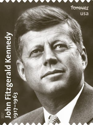 The United States Postal Service's new forever commemorative stamp, featuring a photo of John F. Kennedy taken by Hudson Valley photographer Ted Spiegel.