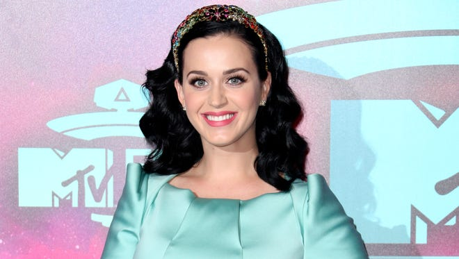In this Nov. 10, 2013 file photo, U.S. singer Katy Perry poses at the 2013 MTV Europe Music Awards, in Amsterdam, Netherlands.