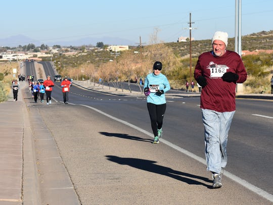 New Mexico State University-Alamogordo President Dr. Ken Van Winkle runs in the annual Lady of the Mountain Run on Saturday morning. Van Winkle finished third place in his age division in the 5K race.