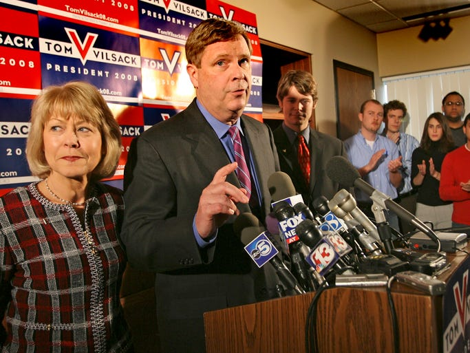 Former Iowa Gov. Tom Vilsack announces his withdrawal from the 2007 presidental campaign at his headquarters in Des Moines, Friday, Feb. 23, 2007. To his right is his wife Christie and to his left is their son Doug.