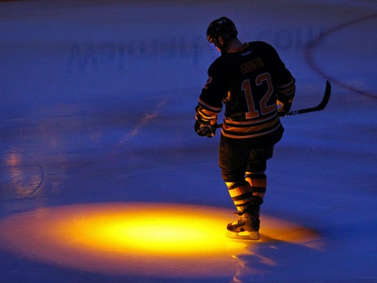 Brian Gionta looks on prior to his 1,000th career NHL