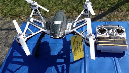 This Aug. 24, 2015, file photo shows a Yuneec Typhoon drone and controller in Jessup, Md. Maryland State Police and prison officials say two men planned to use the drone to smuggle drugs, tobacco and pornography videos into the maximum-security Western Correctional Institution near Cumberland, Md. Illinois has yet to see a case where drones have been used to illegally smuggle items into correctional facilities, according to state officials, but lawmakers are proposing legislation to penalize the activity after seeing what's happened in other states.