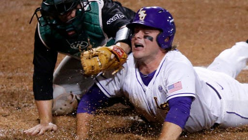 LSU's Bryce Jordan is tagged out at the plate by Utah Vally catcher Zac Willis to end the third inning of an NCAA college regional baseball game in Baton Rouge.